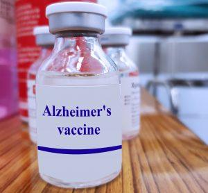 glass vial labelled 'Alzheimer's Vaccine'