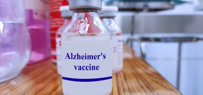 glass vial labelled 'Alzheimer's Vaccine'