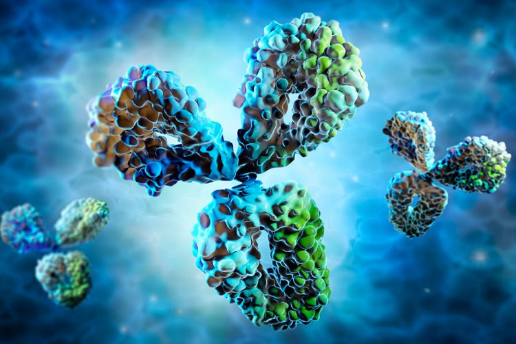 computer generated image of antibodies in blue, grey and green on a blue gradient background