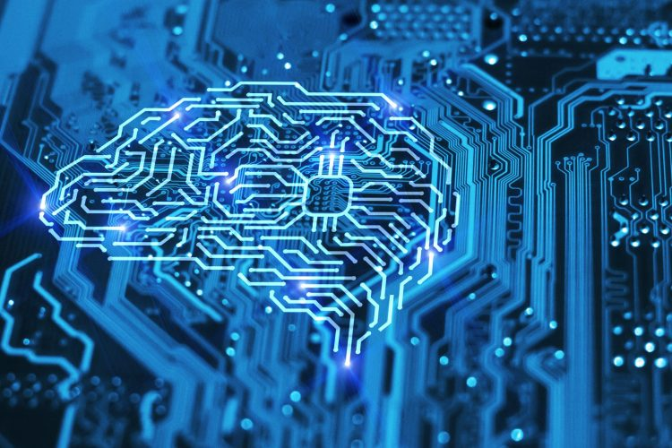Brain lit up in blue on a circuit board - idea of machine learning/artificial intelligence