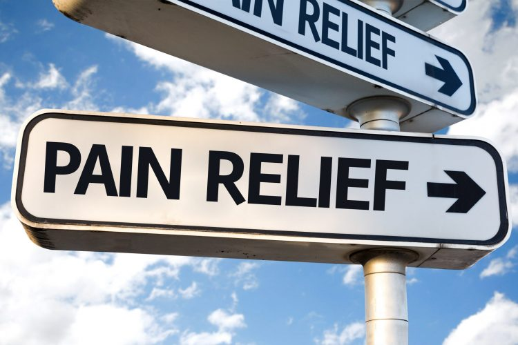 sign saying pain relief to the right