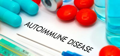 tablets, syringes and drug vials surrounding the words 'autoimmune disease'