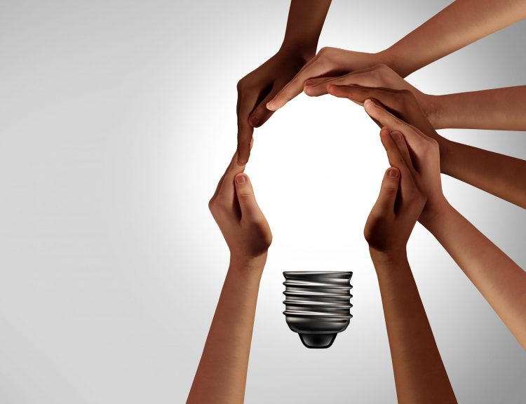 hands coming together to create a lightbulb