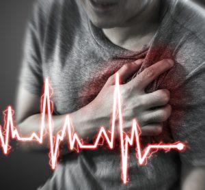 man having a heart attack, with cartoon heart rhythm overlaid