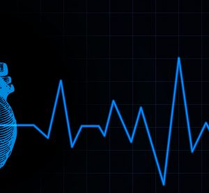 blue heart sketch overlaid with heartbeat