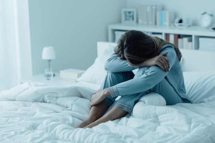 Depressed woman on bed