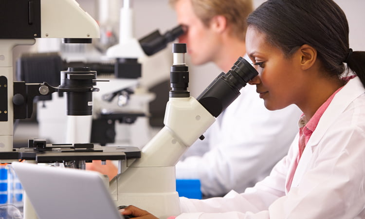 Female and male scientists in lab